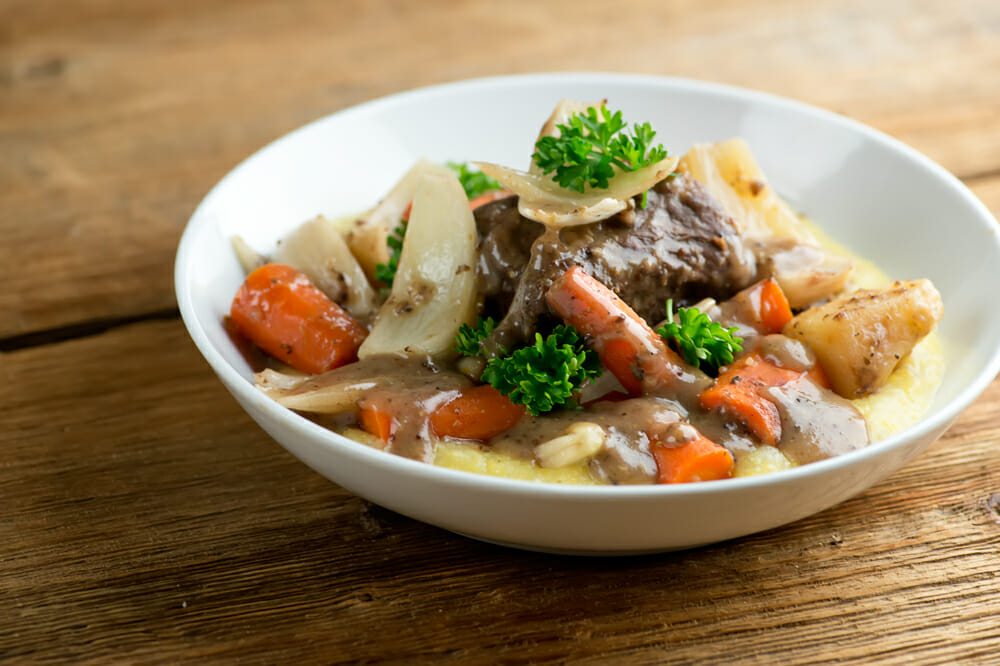 show cooker short ribs with carrots and apples