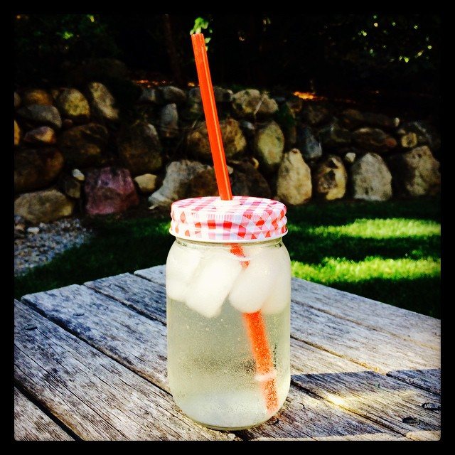One of my favorite vacation purchases: Mason jar with straw. Currently holding a wine spritzer. :)