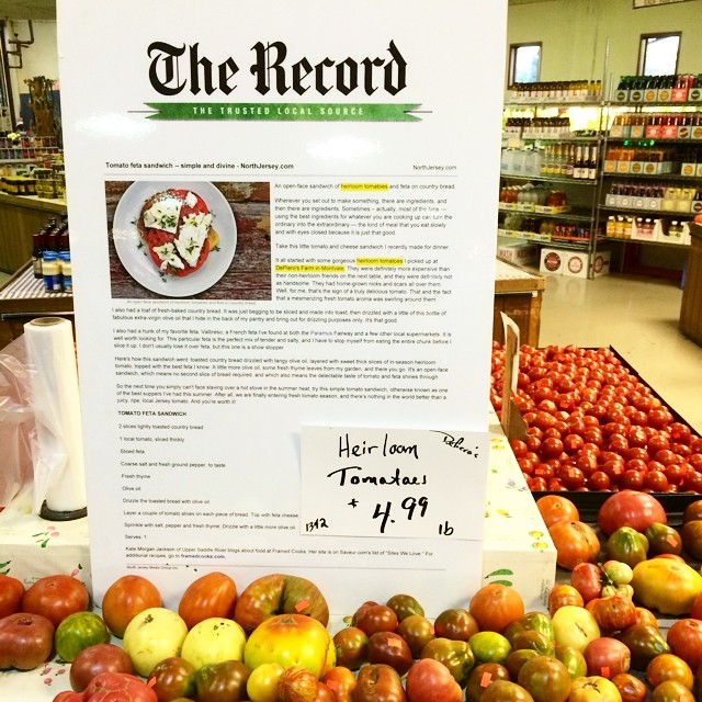 Happiness is seeing one of your newspaper articles blown up to giant proportions and nestled among the heirloom tomatoes at your local farm market.