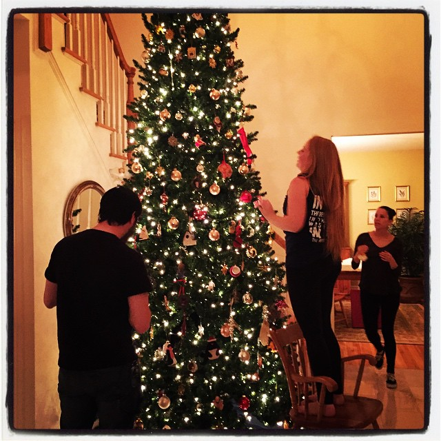 Happiness is the home for the holidays college kids decorating your 12 foot Christmas tree while you watch from the comfort of your comfy chair.