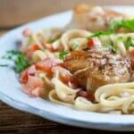 Seared scallops with tomato cream sauce