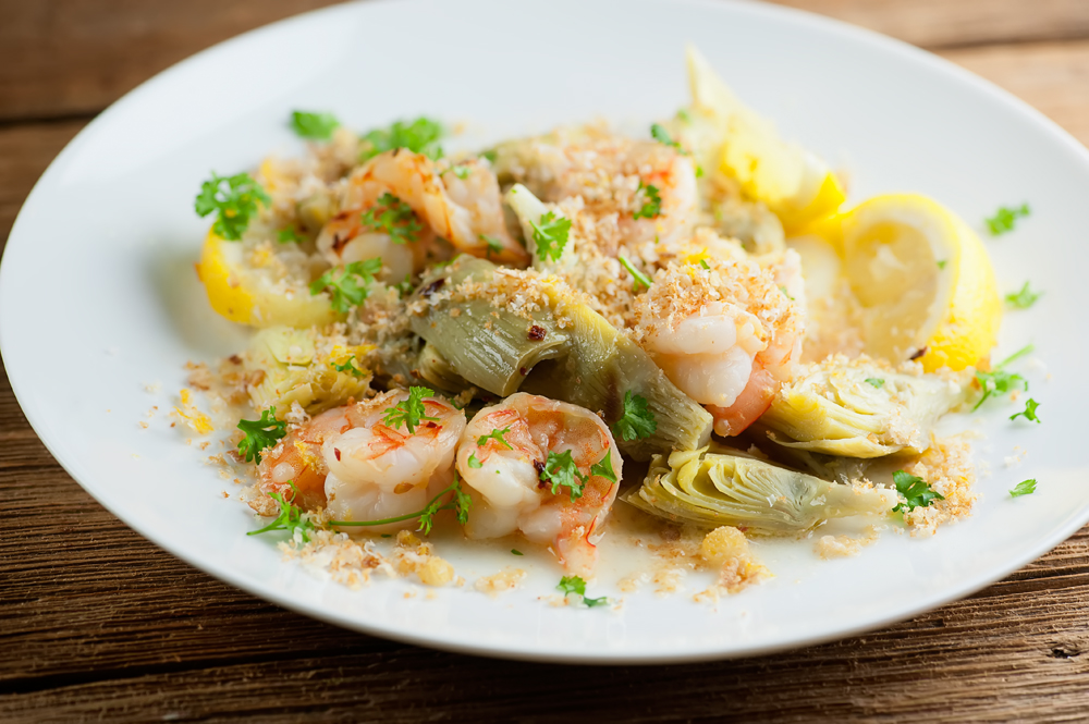 This easy recipe for lemon artichoke shrimp scampi gets cooked on the grill for super simple cooking and clean-up. Full of bright springtime tastes with a flavorful breadcrumb topping.
