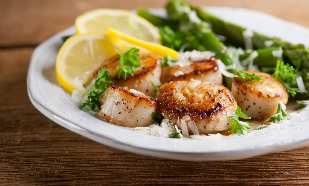 This easy recipe for scallops in lemon butter sauce makes a restaurant quality dinner in no time! Seared scallops in a delicate sauce topped with a dusting of parmesan cheese.
